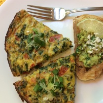Baked omelette with potato, cheese and spinach