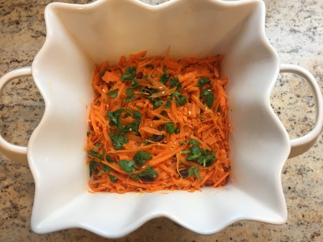 Fresh shredded carrots with sesame seeds and lime,