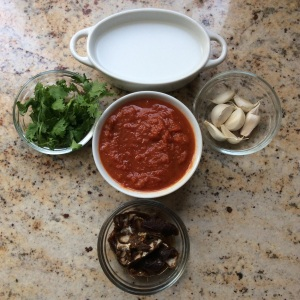 Figure 2: From left to right: cilantro, strained coconut milk. garlic, tamarind with tomato paste in the center. © 2015 Sangeeta Pradhan