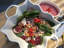 Beet, radish salad with baby spinach and strawberry mint dressing