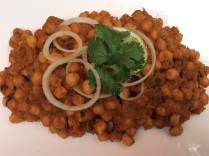 Chickpeas tossed with a delectable onion-tomato sauce.