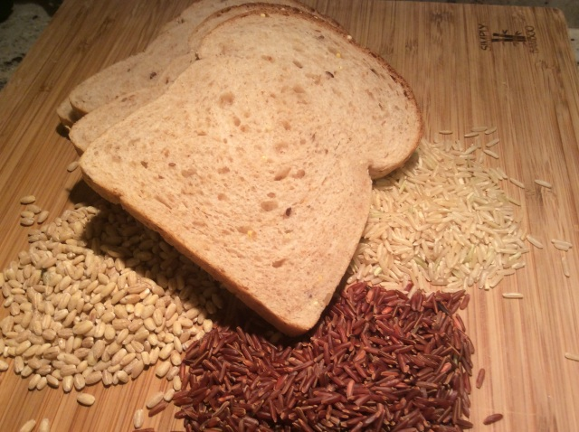 Clockwise: Whole grains from red rice, barley, whole wheat bread and brown r© Copyright 2015 Sangeeta Pradhan, RD, LDN, CDEice.