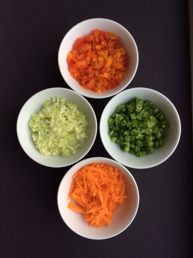 Carrots, peppers, cabbage and green beans are finely grated or chopped for the filling. ©Copyright, Sangeeta Pradhan, RD, LDN, CDE